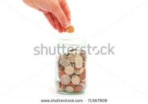 stock-photo-hand-putting-penny-in-a-coin-jar-saving-money-71567908