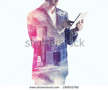 stock-photo-double-exposure-of-city-and-businessman-using-digital-tablet-190655768