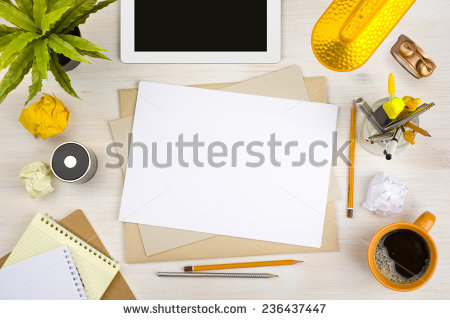 stock-photo-top-view-of-office-desk-with-paper-stationery-and-tablet-computer-236437447